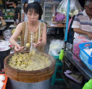 Vendeuse de bouchons à Chiang Rai
